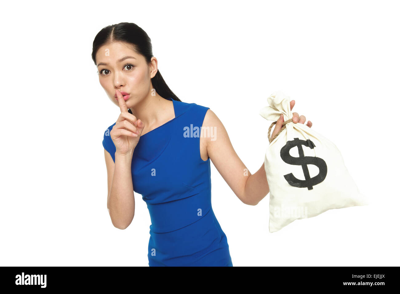 The young woman index finger on the lips and took the purse - Stock Image