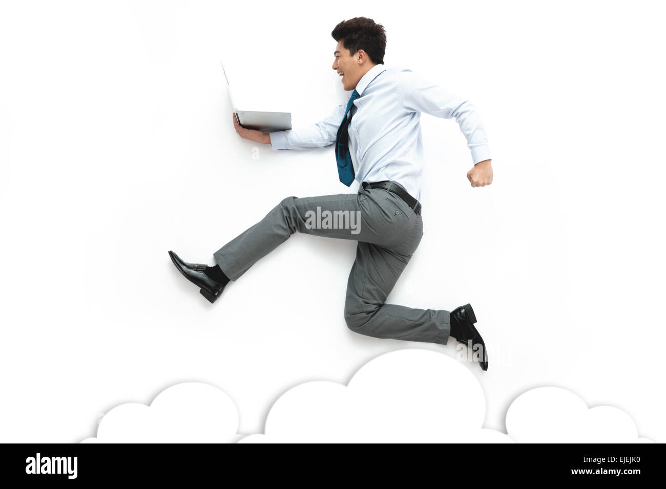 Business men holding laptop running on a white background Stock Photo
