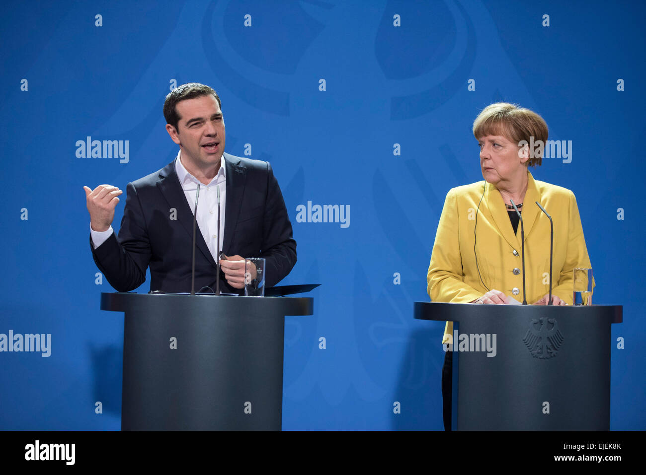 German Chancellor Angela Merkel, right, and the Prime Minister of Greece Alexis Tsipras brief the media during a - Stock Image
