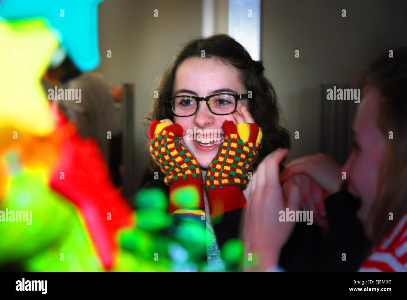 Schoolgirl having fun at carnival, Netherlands - Stock Image