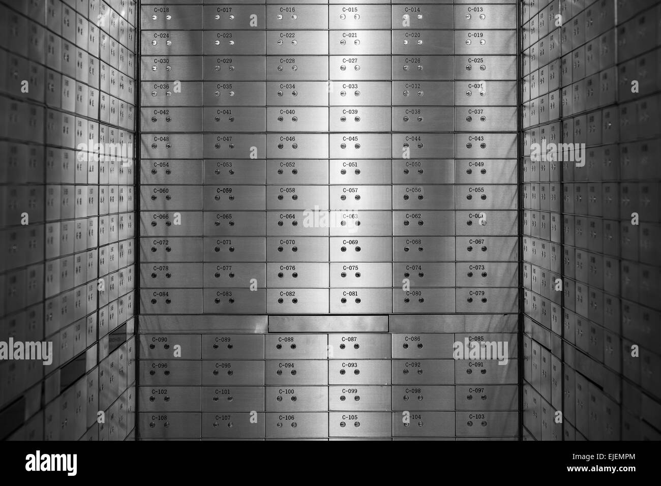 A room full of safety deposit boxes in a bank vault - Stock Image