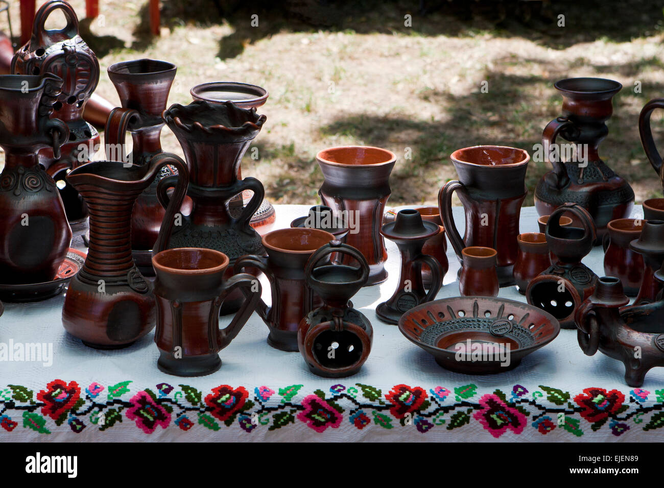 Handmade pottery at an exhibition of traditional products - Stock Image