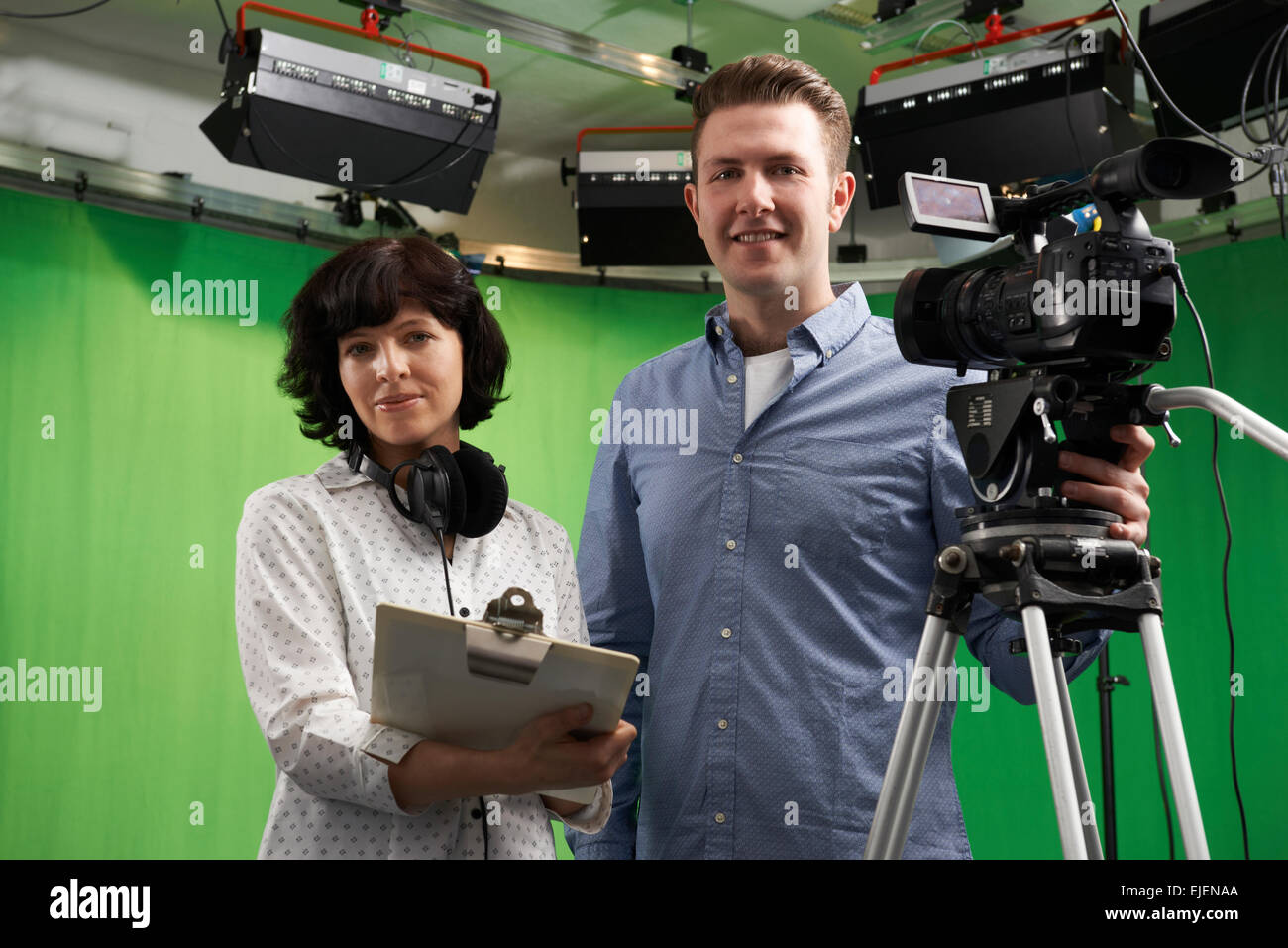 Portrait Of Cameraman And Floor Manager In Television Studio - Stock Image