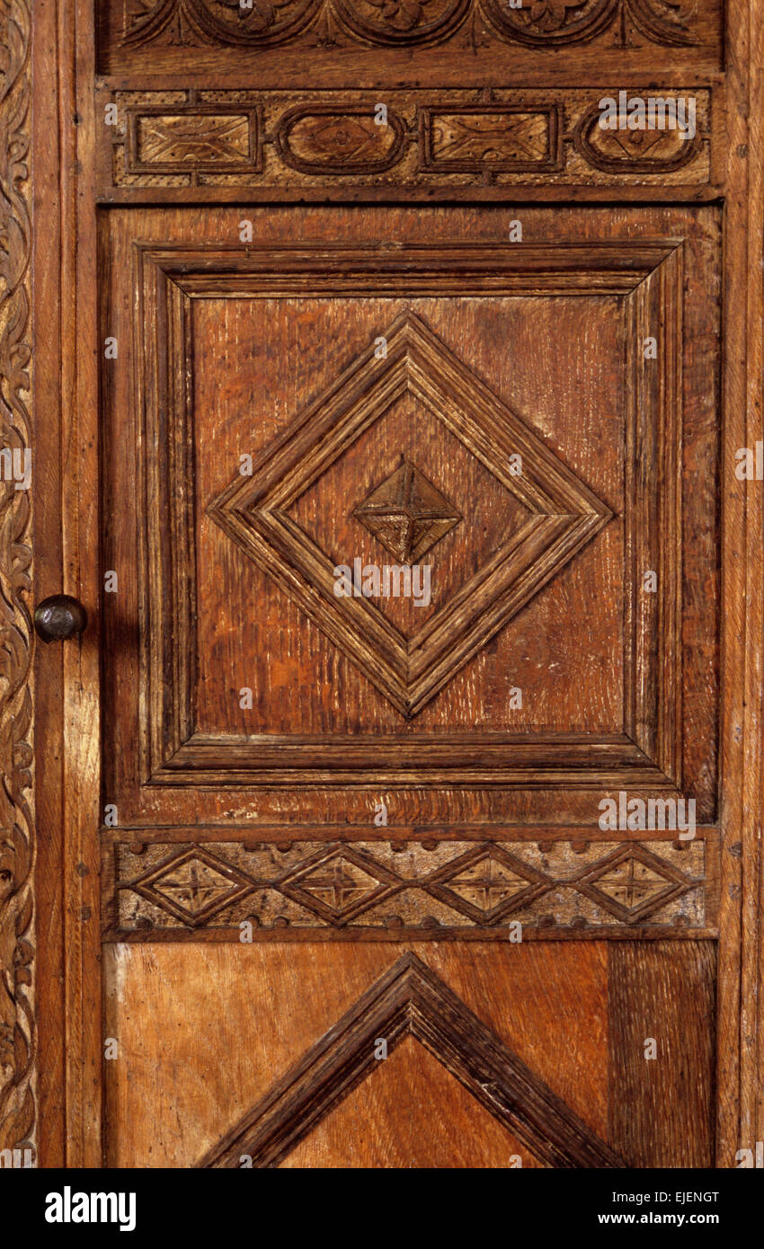 Detail of geometric carving on wooden door of 17th-century church pulpit - Stock Image