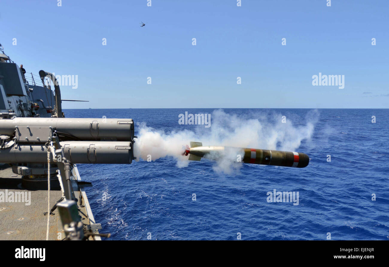 A US Navy MK 54 Lightweight Hybrid dummy torpedo launches from the Arleigh Burke-class guided-missile destroyer - Stock Image