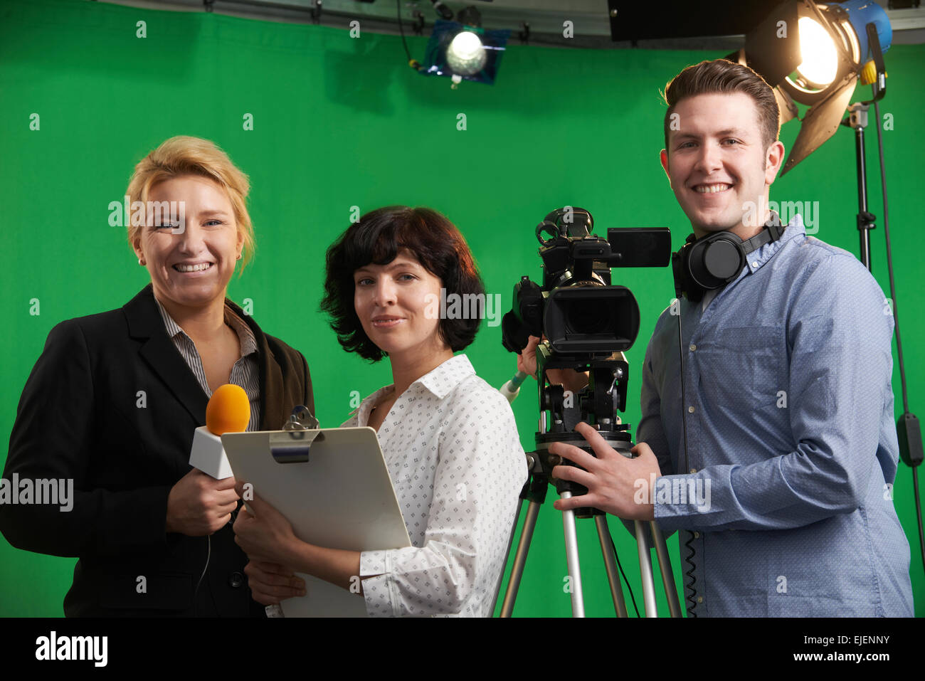 Portrait Of Cameraman With Presenter And Floor Manager In Television Studio - Stock Image