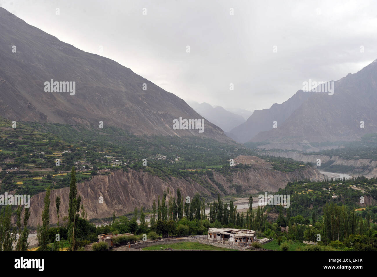 Hunza valley as viewed from Karimabad. Diran is the mountain to the left and Rakaposhi is to the right. Pakistan, - Stock Image
