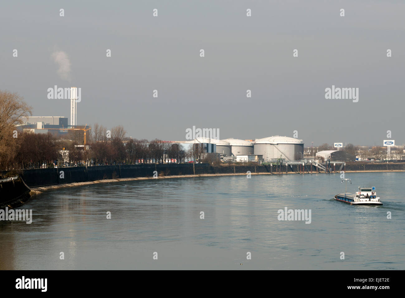 Industry beside the river Rhine, Niehl, Cologne, Germany. Stock Photo