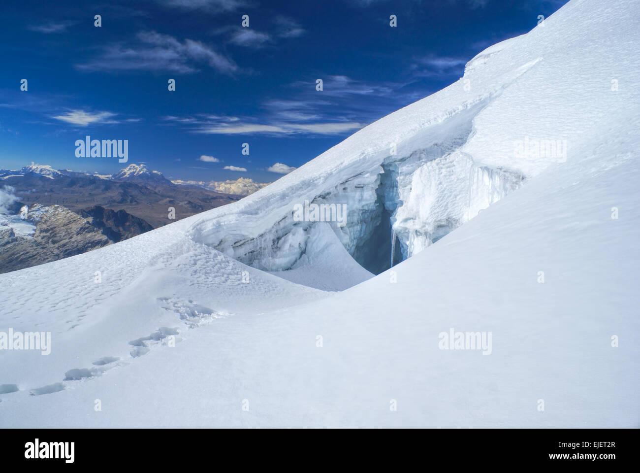 Crevasse in glacier near top of Huayna Potosi mountain in Bolivia - Stock Image
