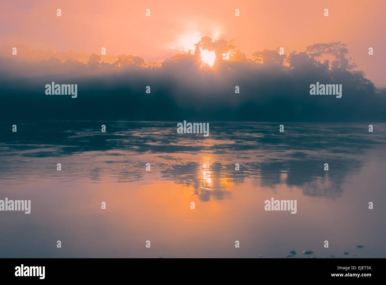 Mystical sunrise above lake in bolivian Andes - Stock Image