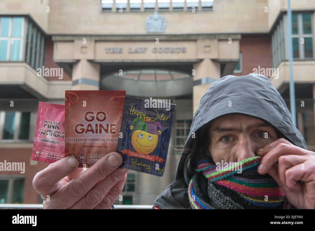 A dealer holds a selection of Legal Highs including Pink Panthers, Go Gaine and Happy Joker. - Stock Image
