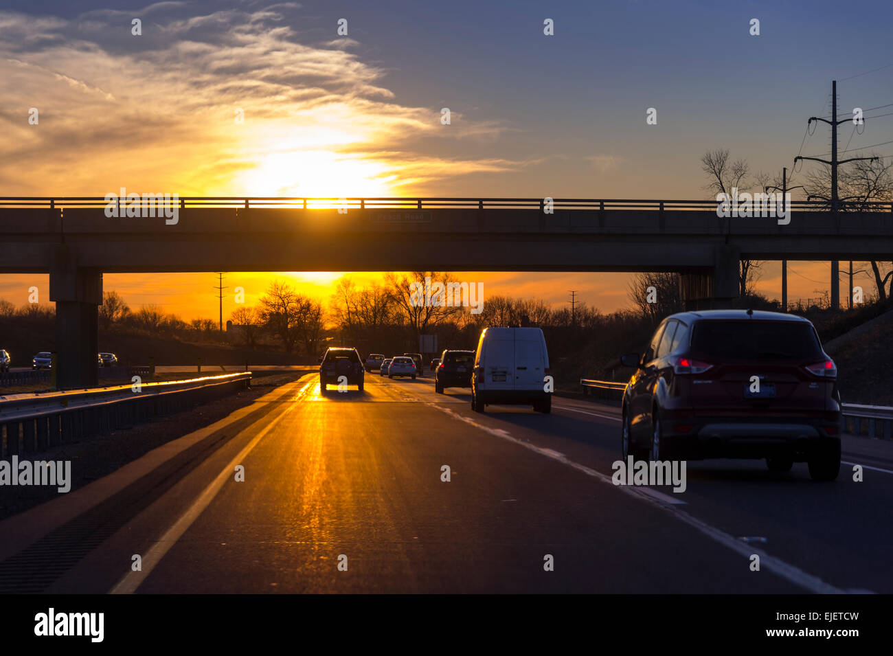 Cars With Sun On Highway During Rush Hour Commute, Philadelphia, USA - Stock Image