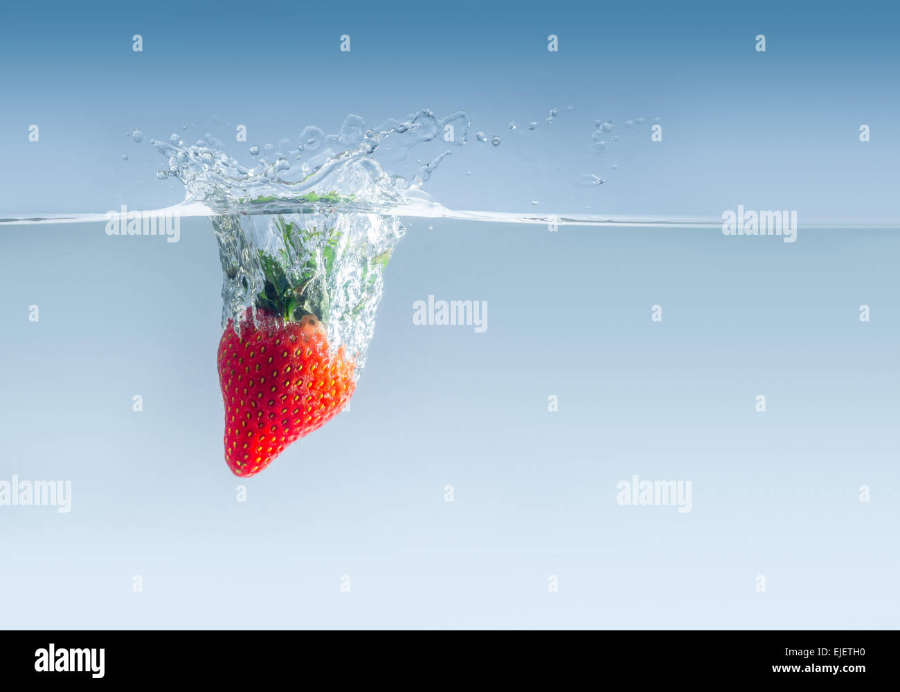 Strawberry in water - Stock Image