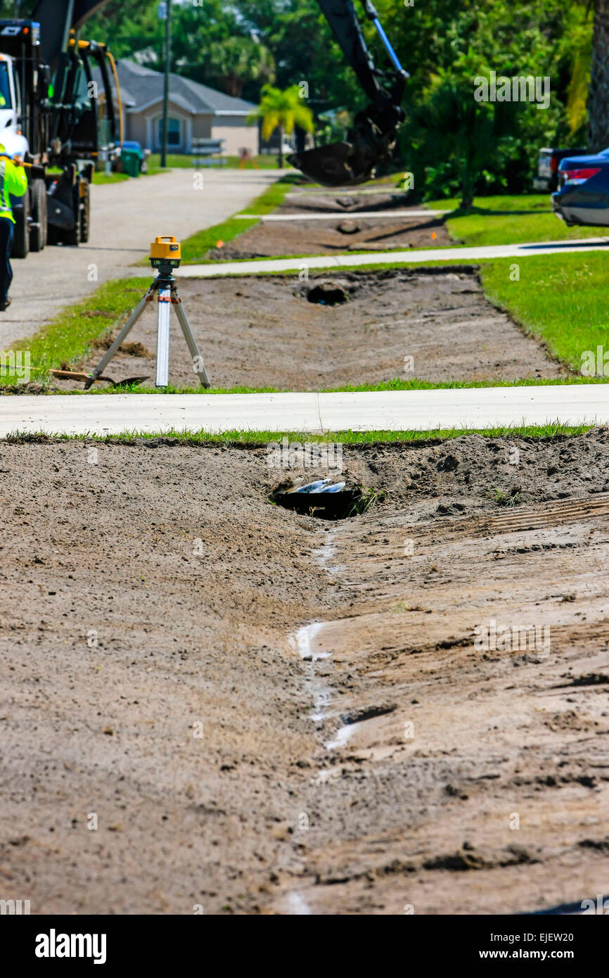 Streets soak-away drainage renewal in a Florida residential neighborhood means the removal of lawns regrading the - Stock Image