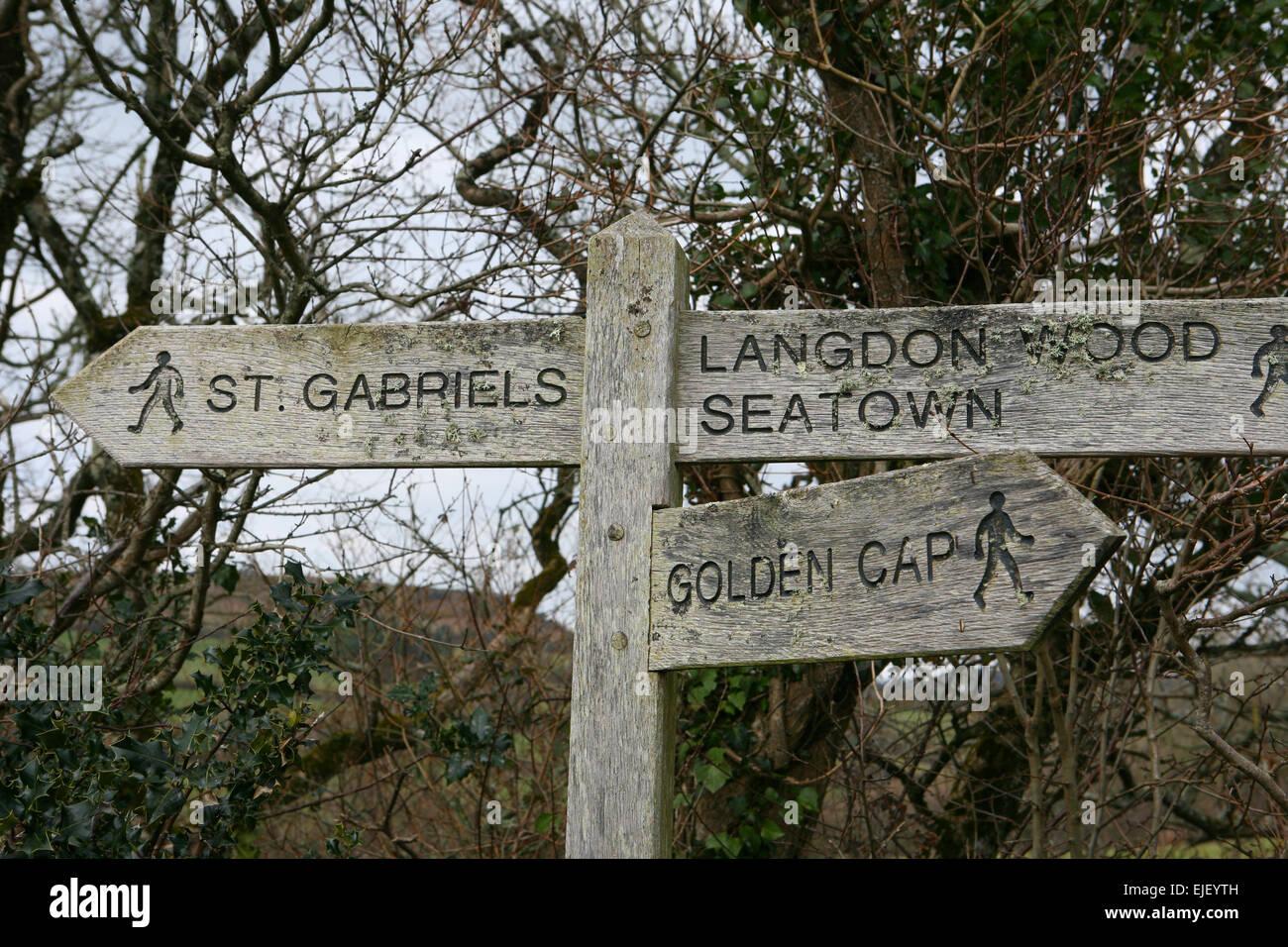 Signpost on the coastal footpath near Seatown - Stock Image