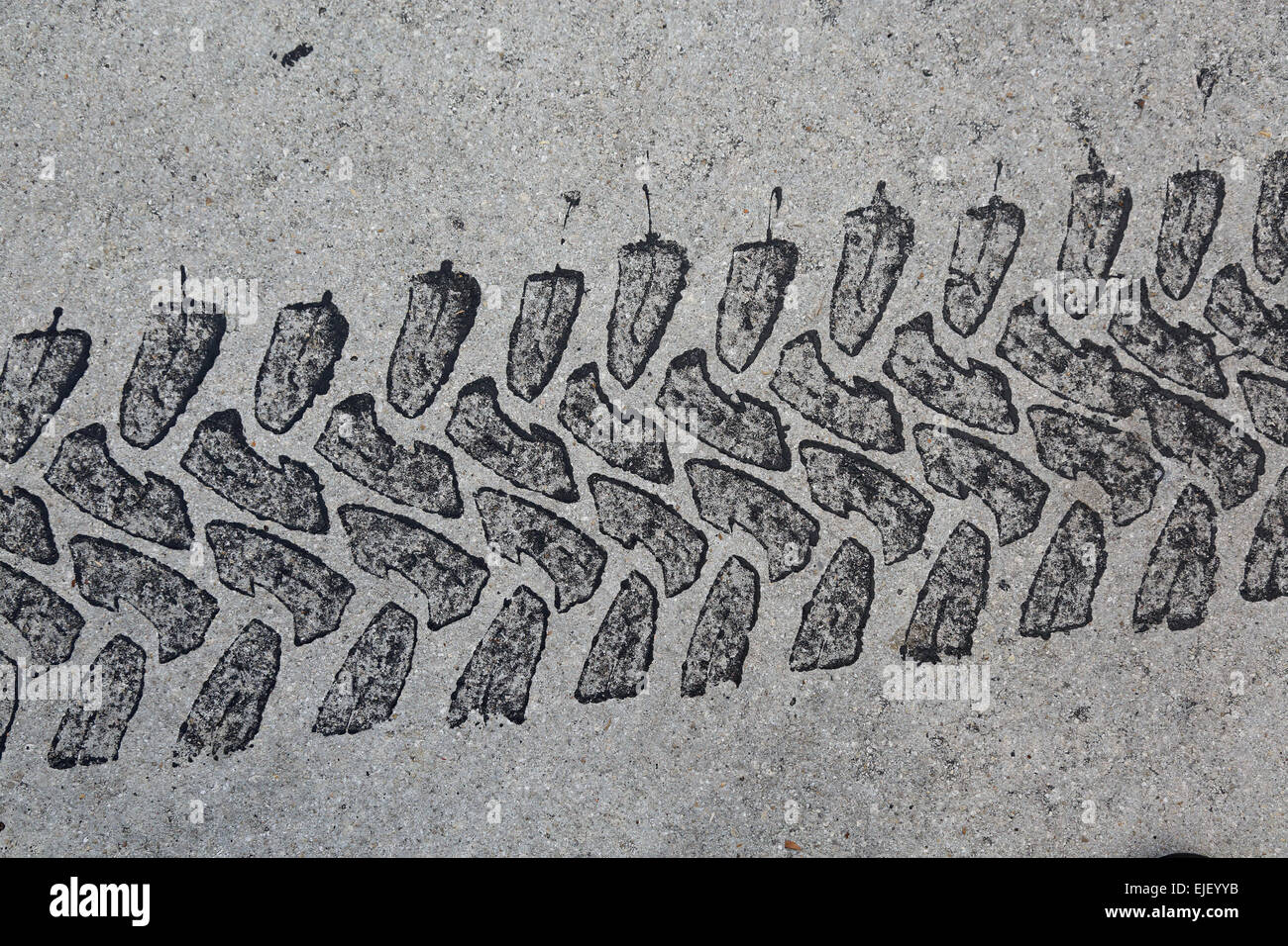 Tire mark, tyre track, on pavement background - Stock Image