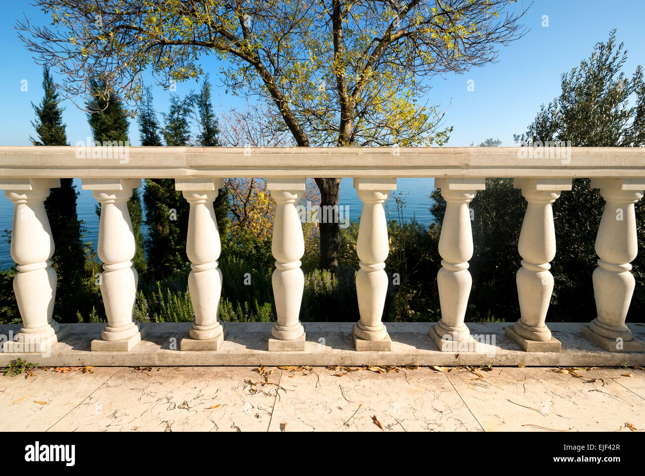 Decorative columns on a viewpoint deck near sea - Stock Image