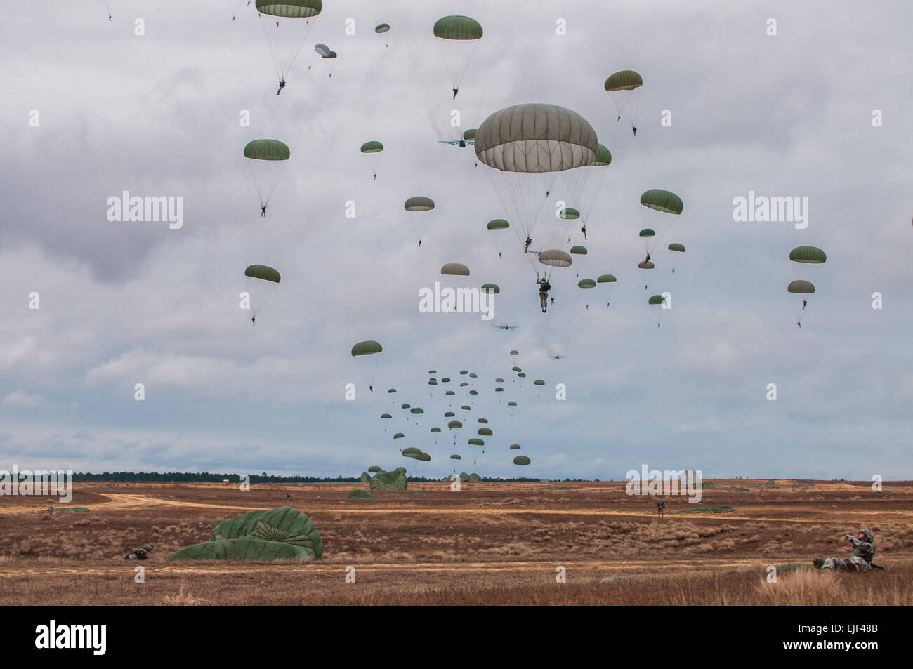Paratroopers descend on Sicily Drop Zone during the 16th Annual Randy Oler Memorial Operation Toy Drop, at Fort - Stock Image