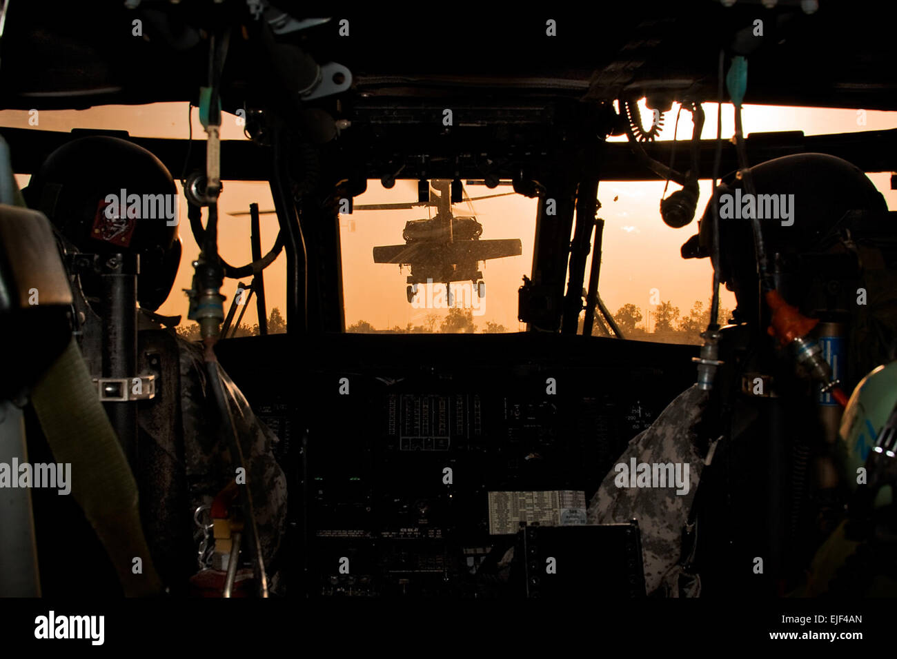 During an early morning start, an orange glow from the sun fills the sky as a team of UH-60 Black Hawk helicopters from Company B, 3rd Battalion, 227th Aviation Regiment, 1st Air Cavalry Brigade, 1st Cavalry Division, Multi-National Division-Baghdad, depart Camp Taji Airfield, Iraq, Aug. 18, 2009. The aircrews are flying to a training area where they will be conducting training with Iraqi army soldiers.   Sgt. Travis Zielinski Stock Photo