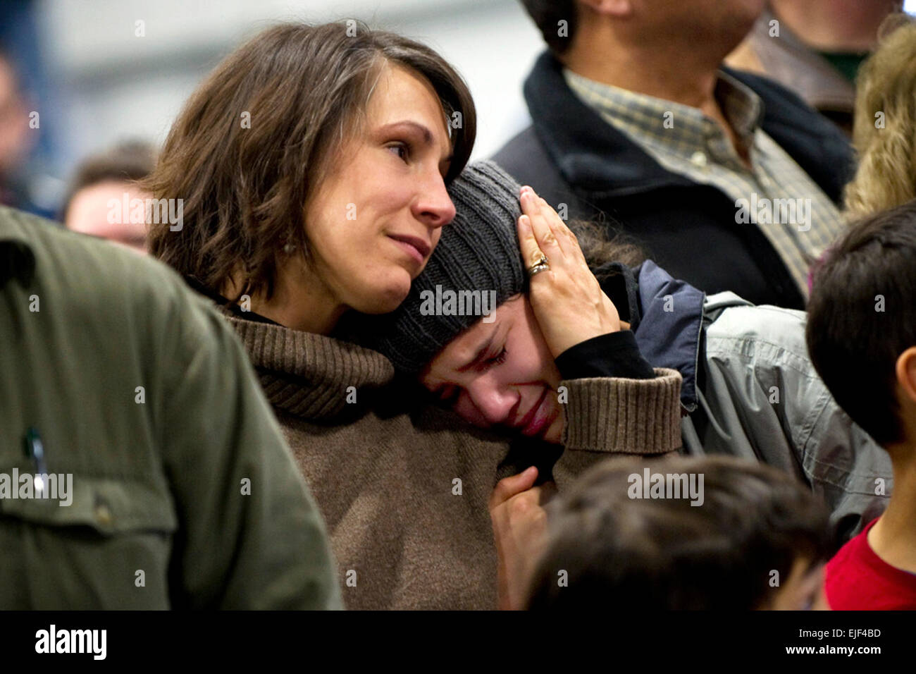 A family cries while watching the 86th Infantry Brigade Combat Team leave after their departure ceremony in Burlington, - Stock Image