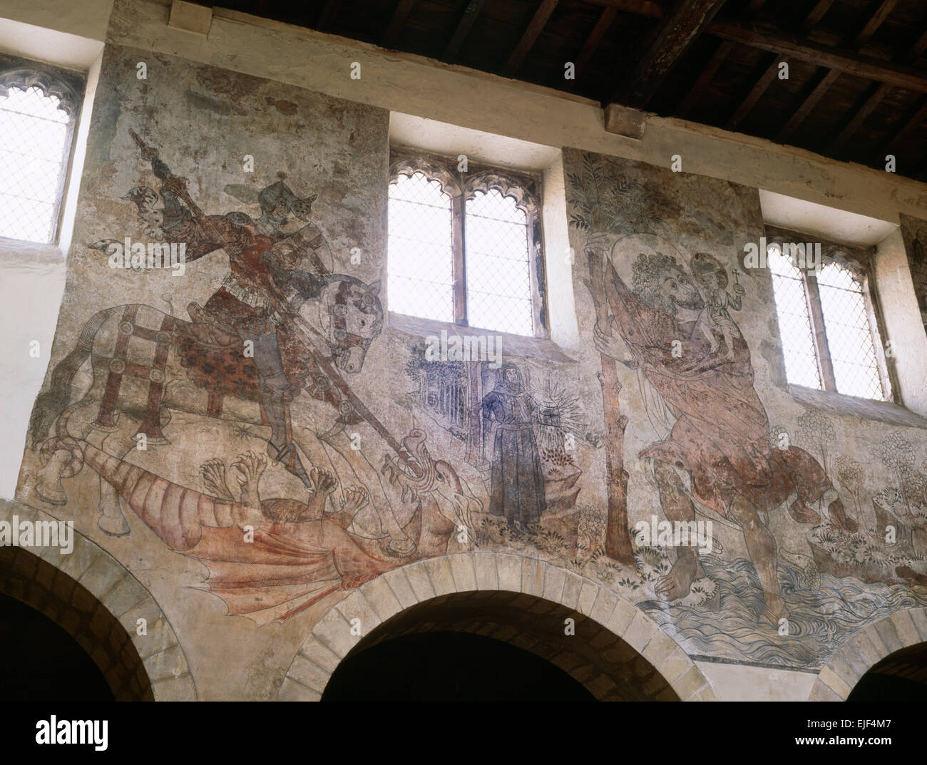 Medieval (1450-60) frescoes in Pickering church, North Yorkshire, depicting St George and the Dragon, and St Christopher - Stock Image