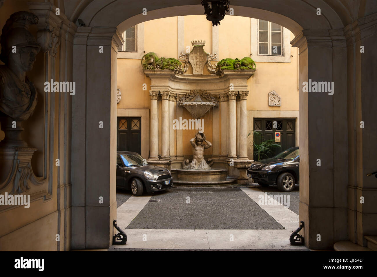 View of a small decorative backyard fountain in Rome Italy - Stock Image