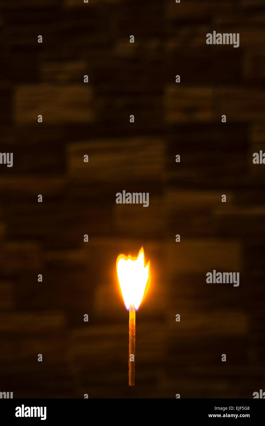 Ignited matchstick in the air - Stock Image