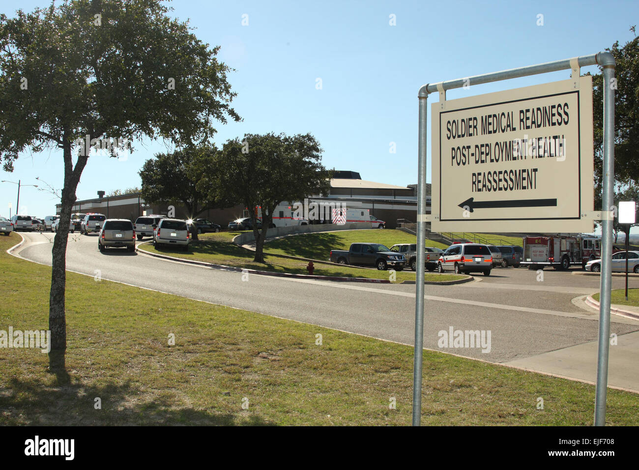 Ambulances line up outside Fort Hood's Soldier Readiness Processing Center in the wake of a gunman's rampage - Stock Image