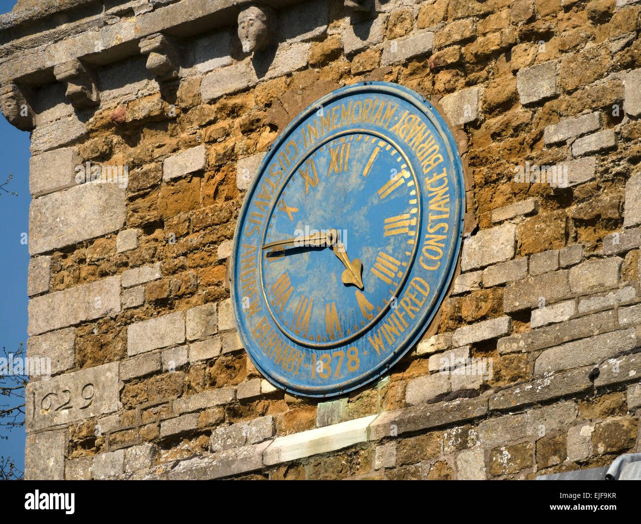 Old church clock with blue face and gold hands and roman numerals, Burrough on the Hill Church, Leicestershire, - Stock Image