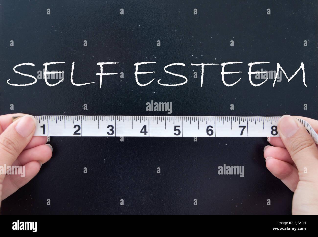 Measuring self esteem - Stock Image