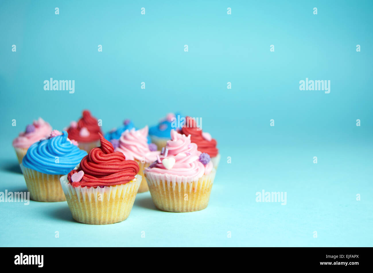 Assorted cream cupcakes with copyspace - Stock Image