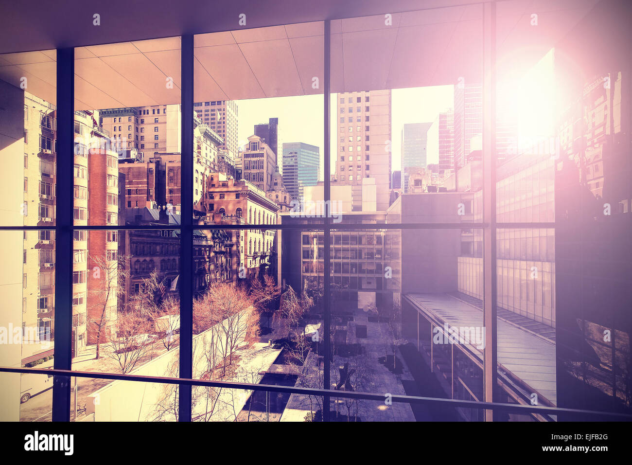 Retro vintage stylized picture of Manhattan with flare effect, New York City, USA. - Stock Image