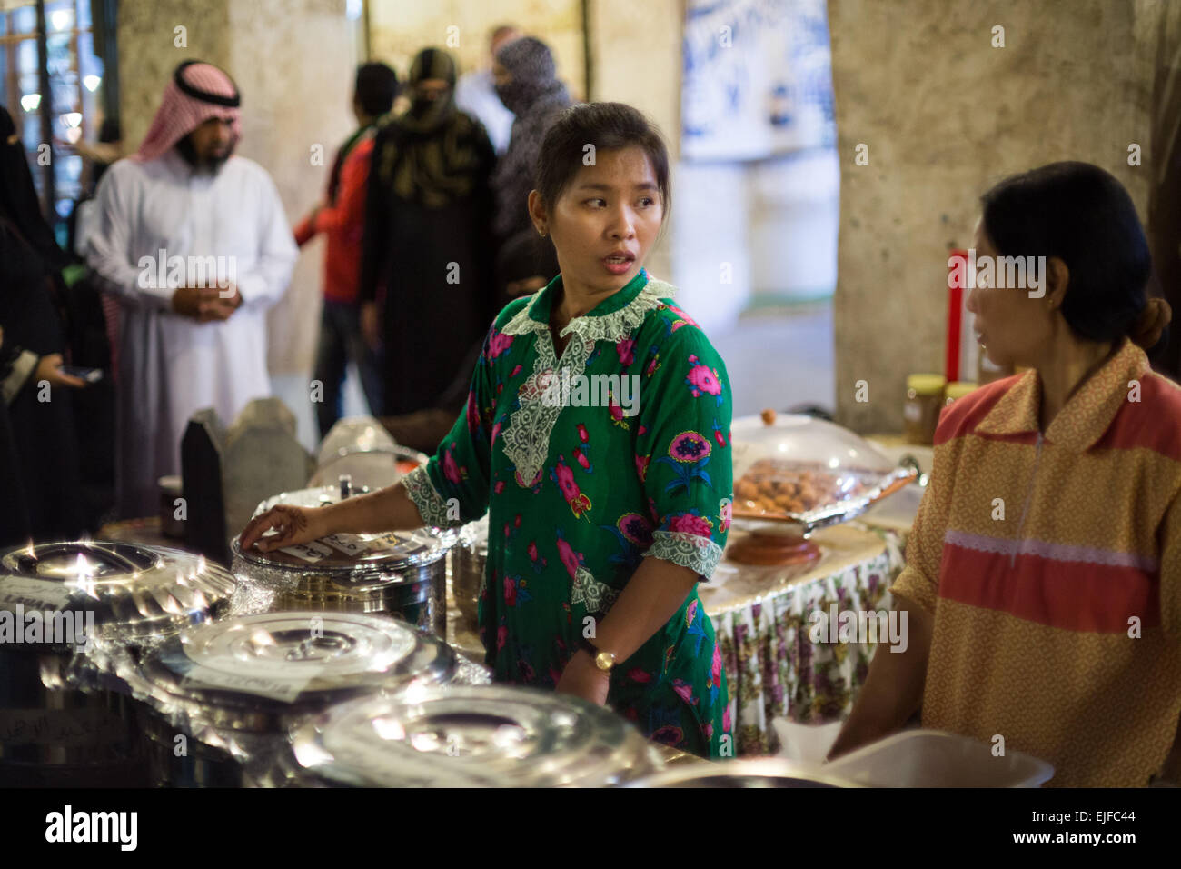 housemaids serve traditional home-made arab food in souq waqif in
