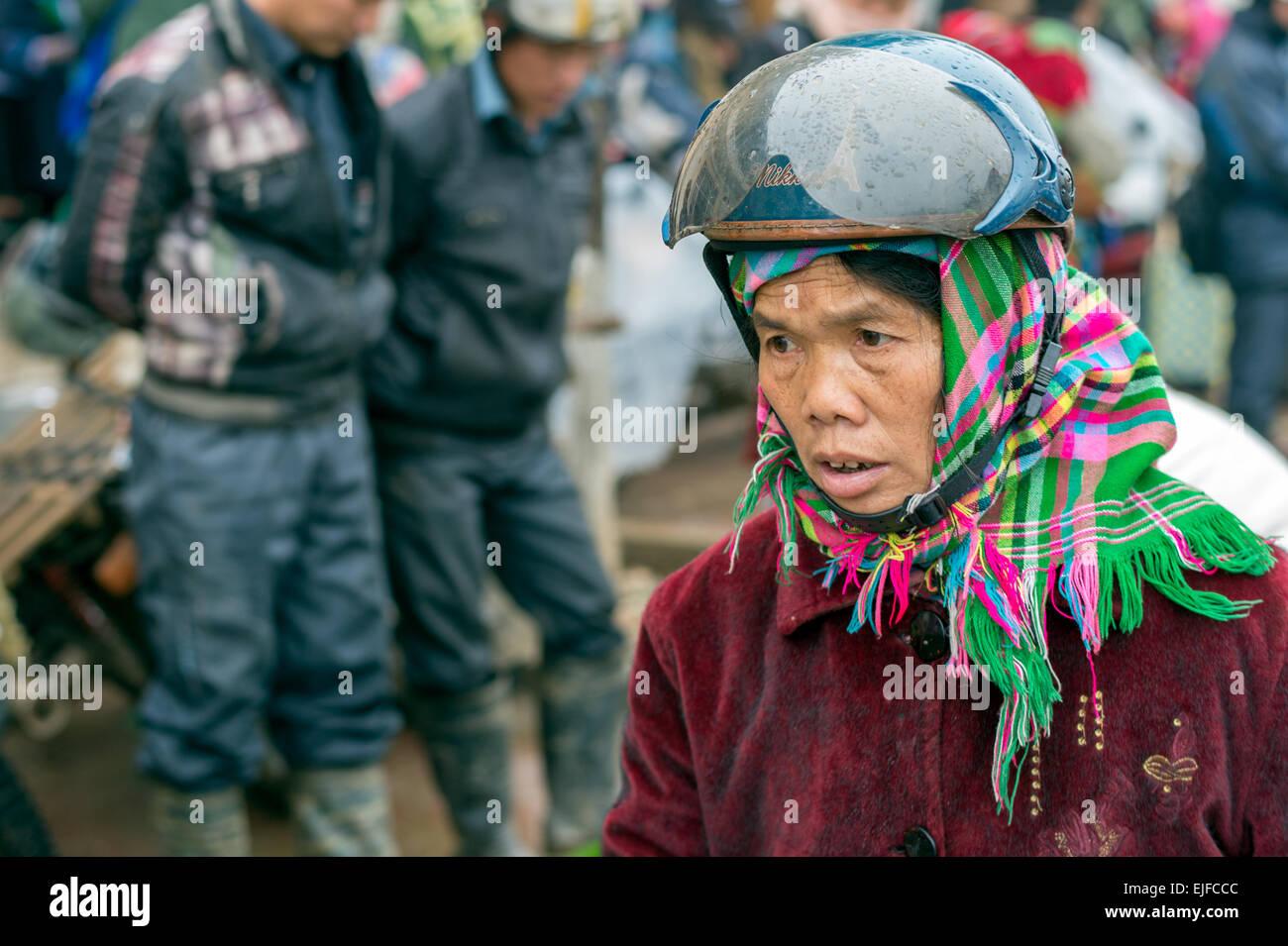 Hmong woman at a market in Sapa, Vietnam - Stock Image