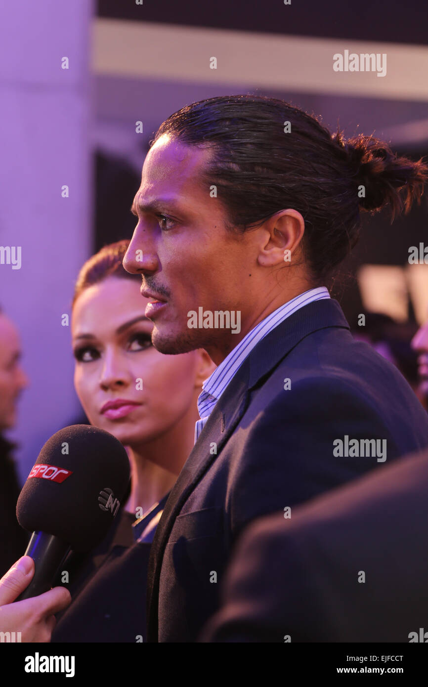 ISTANBUL, TURKEY - MARCH 18, 2015: Footballer Bruno Alves and his wife in Lounge of Mercedes-Benz Fashion Week Istanbul - Stock Image
