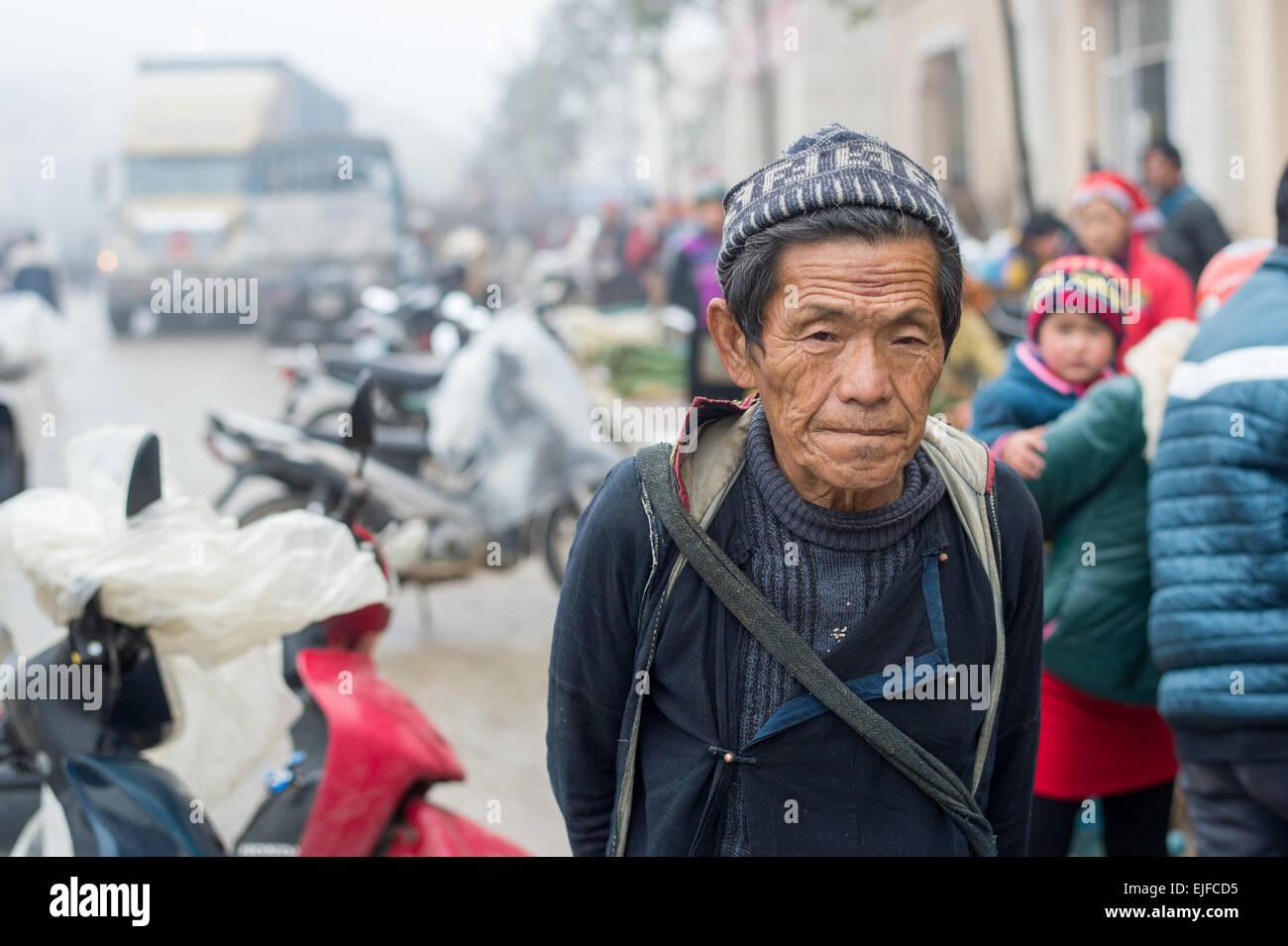 Hmong man at a market in Sapa, Vietnam - Stock Image
