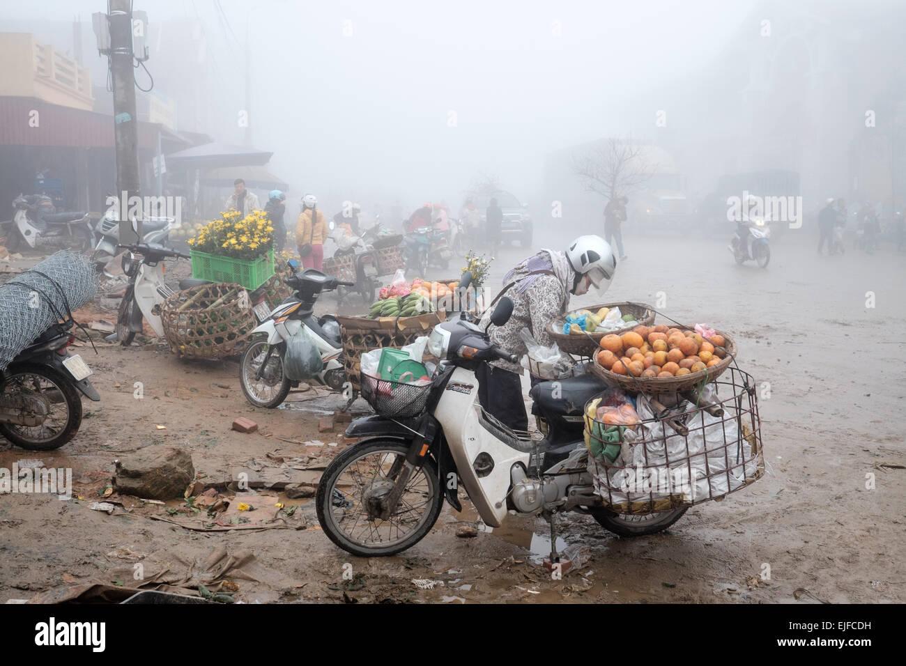 Vietnamese people at a market in Sapa, Vietnam - Stock Image
