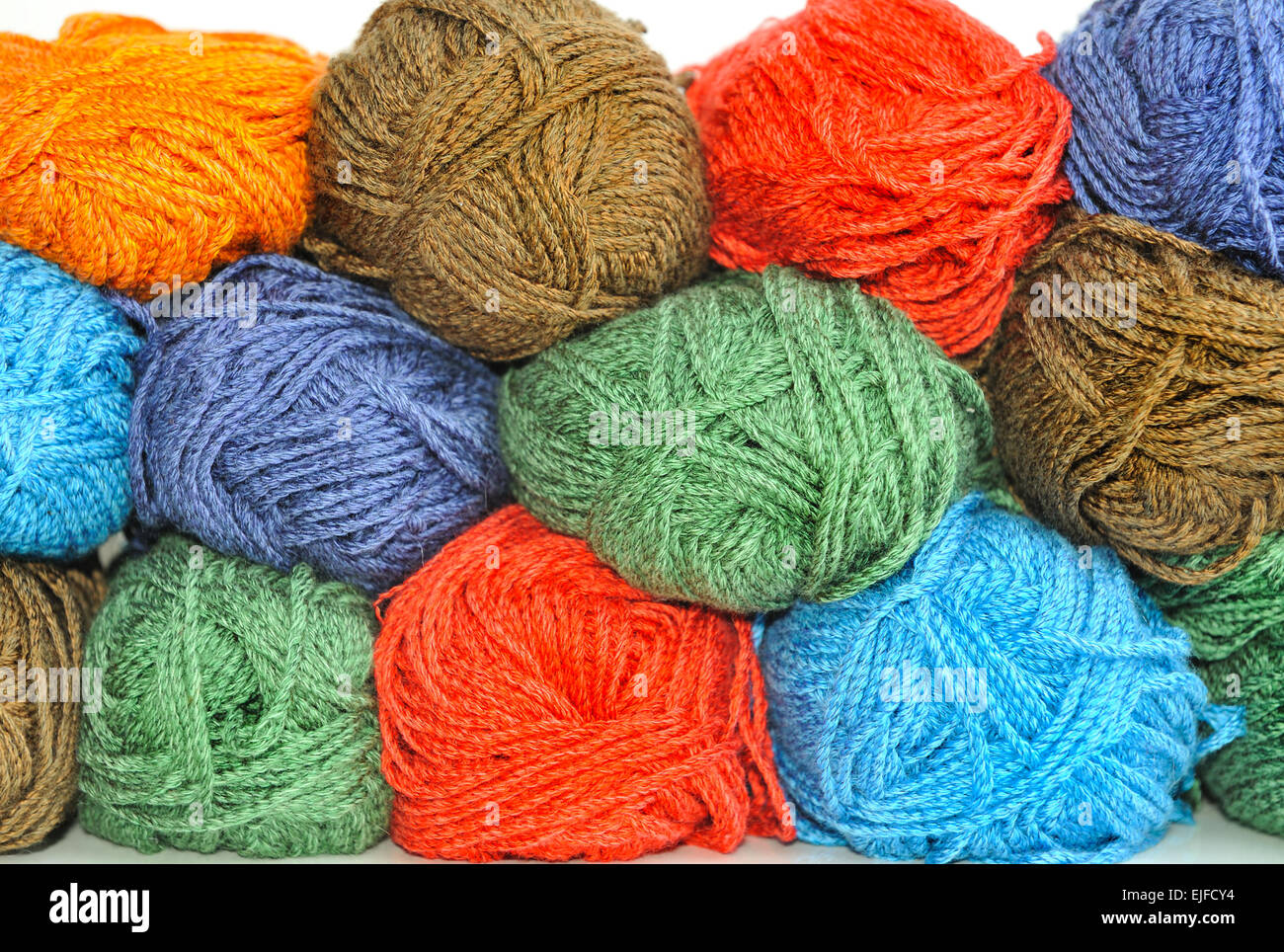 Multi-colored skeins of yarn for knitting. - Stock Image