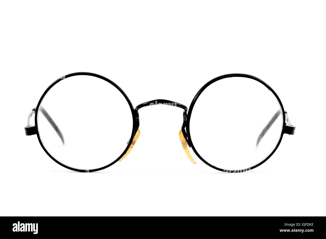 a pair of round-lens eyeglasses on a white background - Stock Image