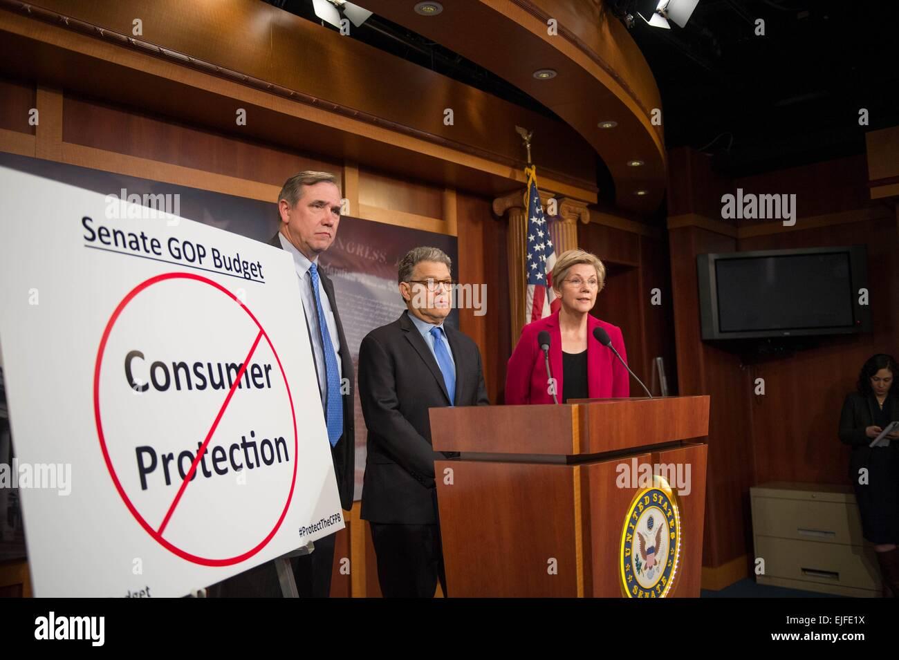 US Senator Elizabeth Warren joined by Senators Al Franken and Jeff Merkley comments on the Senate Republican budget - Stock Image