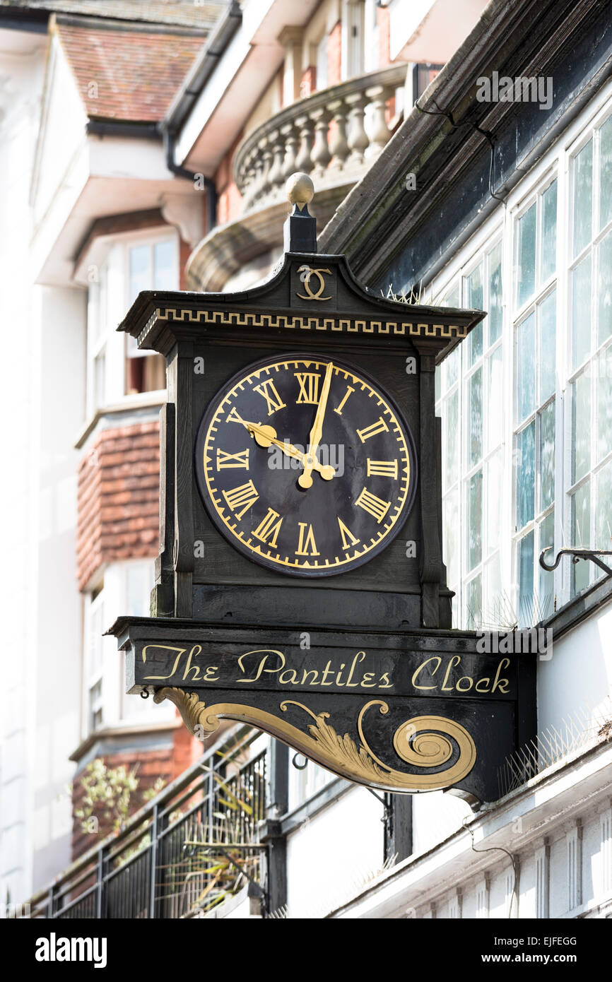 Clock detail with Roman numerals in The Pantiles area of Tunbridge Wells in Kent, England, UK - Stock Image