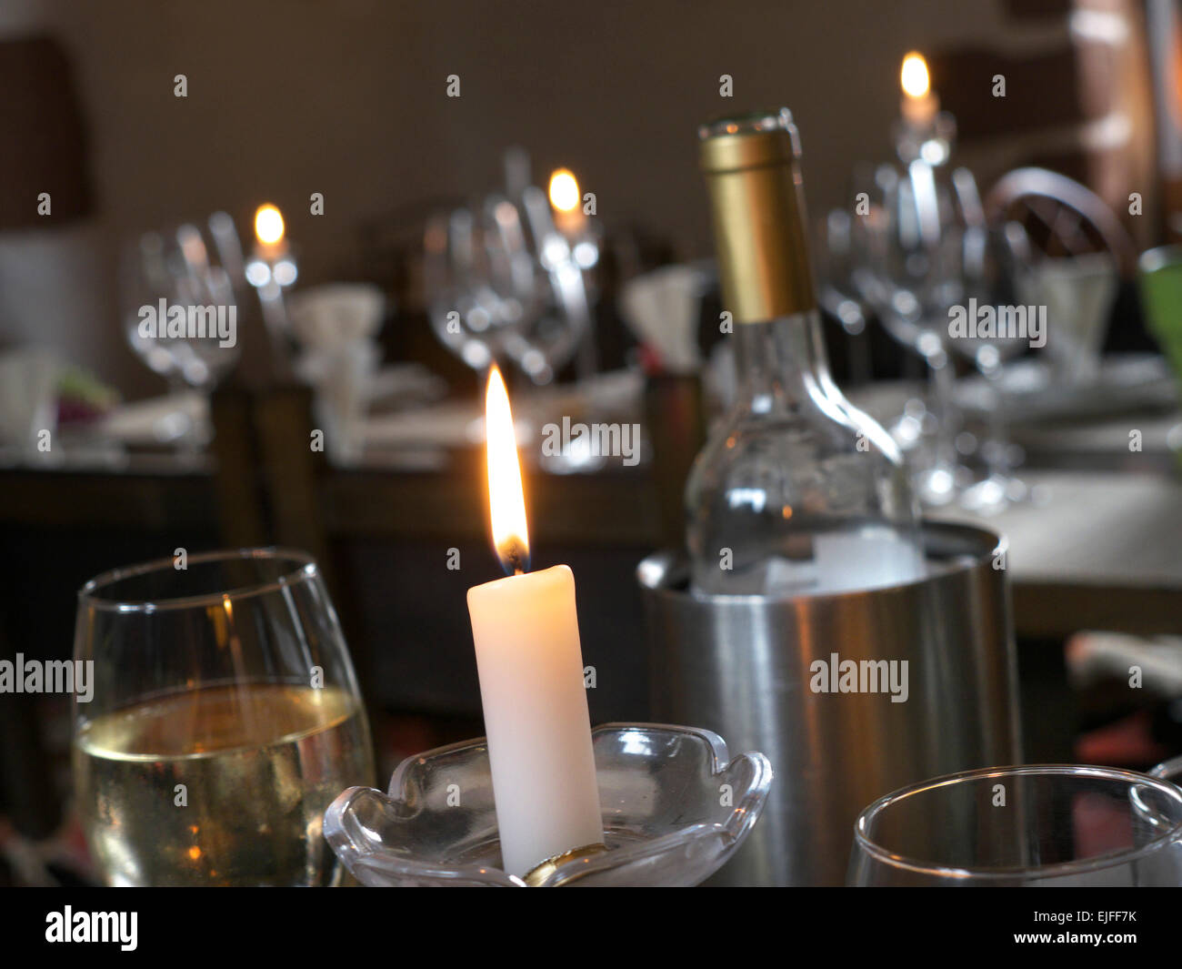 Romantic candlelit dining wine bar restaurant table tables interior - Stock Image