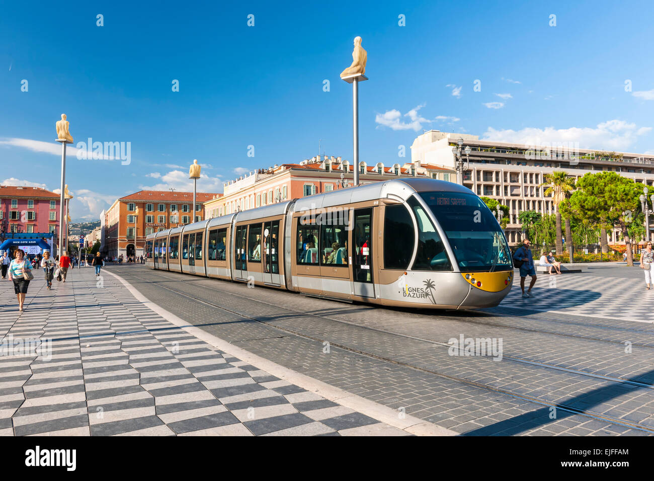 NICE, FRANCE - OCTOBER 2, 2014: Nice tramway at Place Massena, the main pedestrian square of the city. Stock Photo