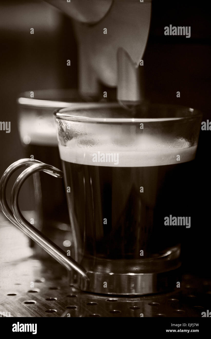 Two small cups of fresh brewed espresso - Stock Image