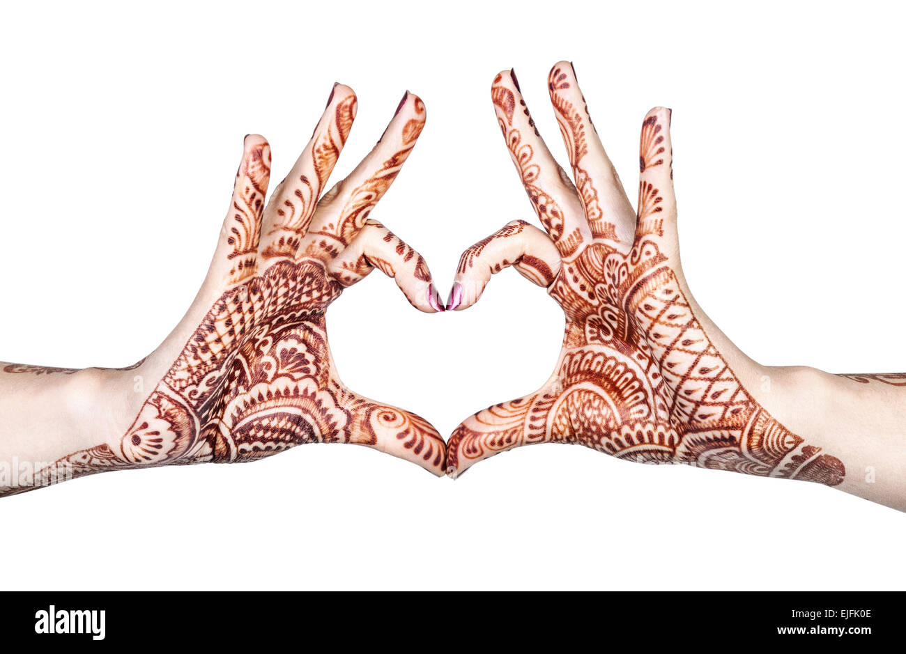 Woman hands with henna doing heart gesture isolated on white background with clipping path - Stock Image