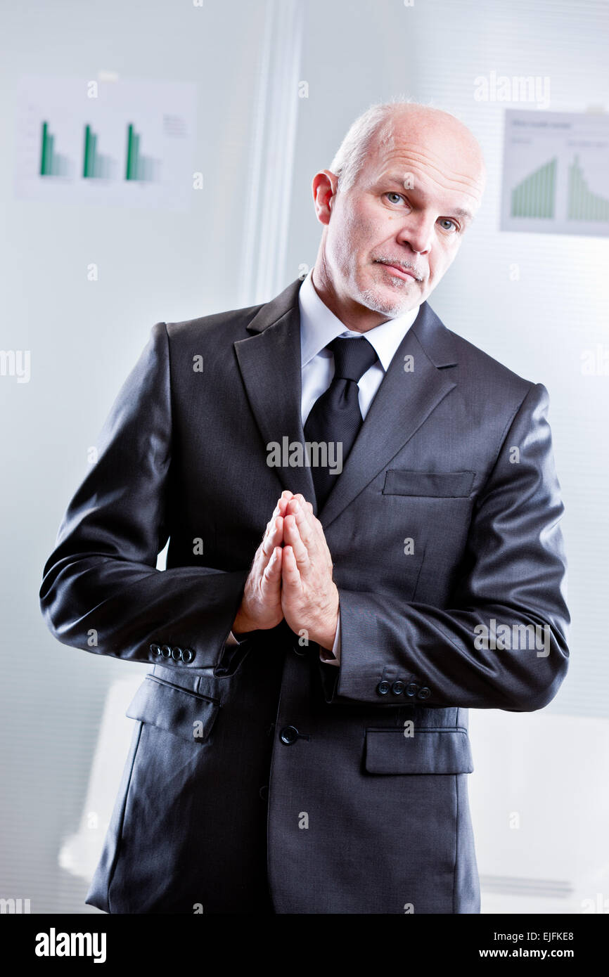 busines man asking you why are you making something in a wrong way - Stock Image