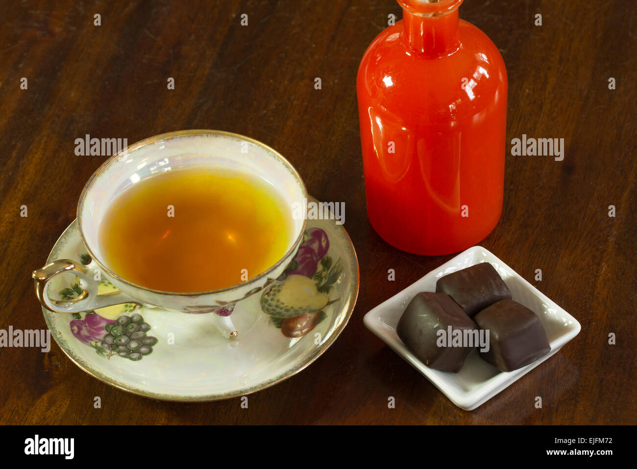 Tea served with chocolate truffles and aroma therapy - Stock Image