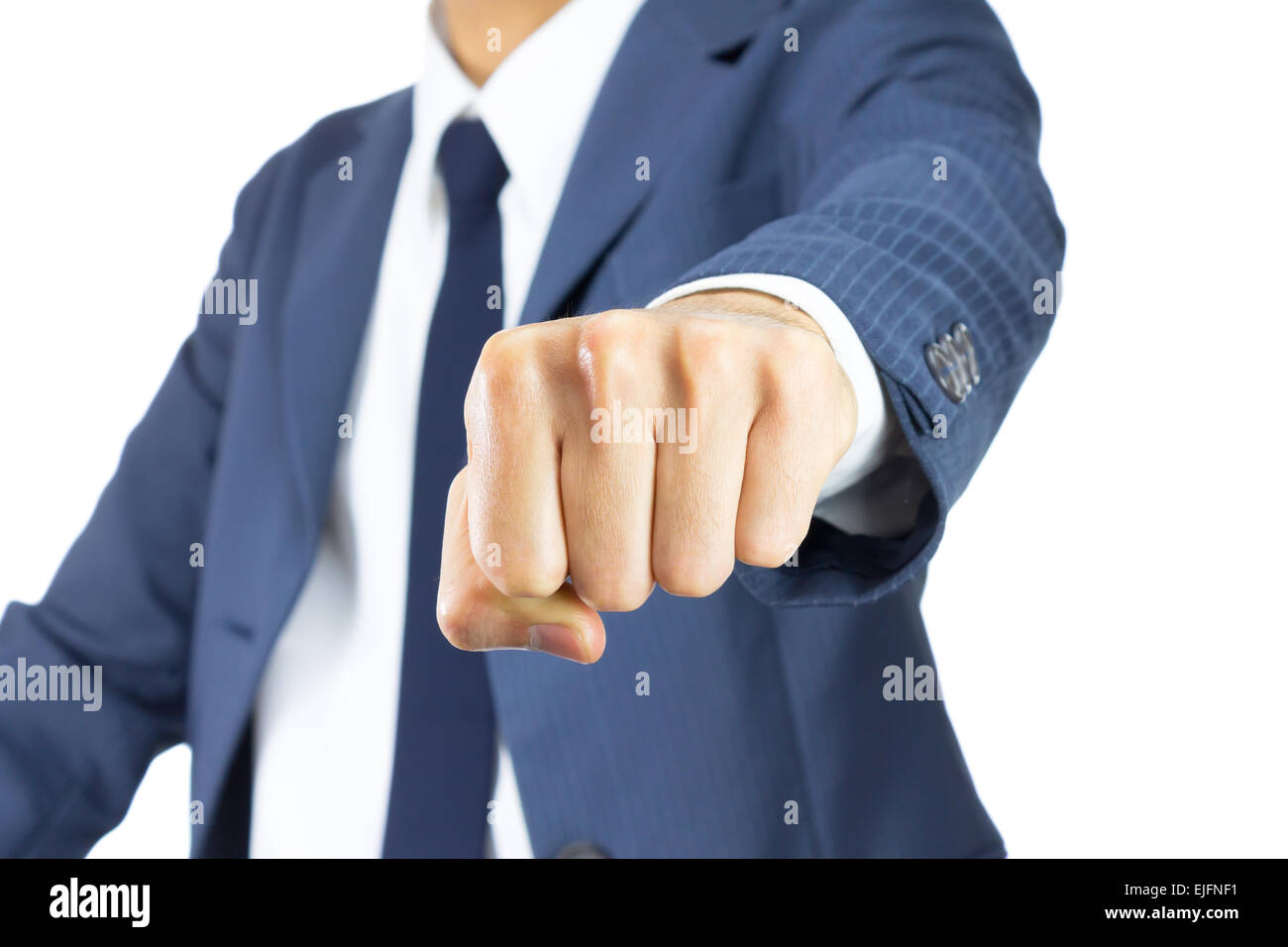 Businessman Fist in Blue Suit Isolated on White Background. Concept about Violence or Strike in Organization - Stock Image