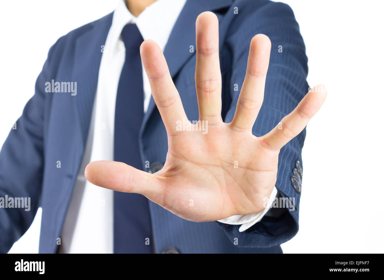 Businessman in Blue Suit Show Stop Sign of Hand Isolated on White Background. Concept about Stopping or Prevent. - Stock Image