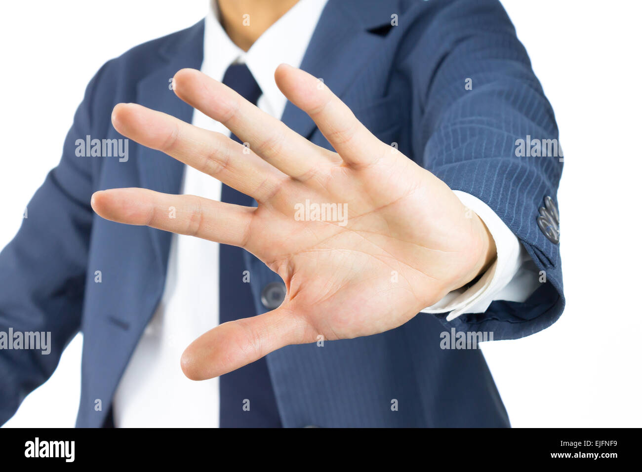 Businessman in Blue Suit Show Stop Sign of Hand on Tilt View Isolated on White Background. Concept about Stopping - Stock Image